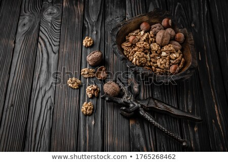 Wooden cracker with walnuts in composition Stock photo © dash