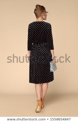 若い女の子 ポーズ 黒 ベージュ ドレス パターン ストックフォト © acidgrey
