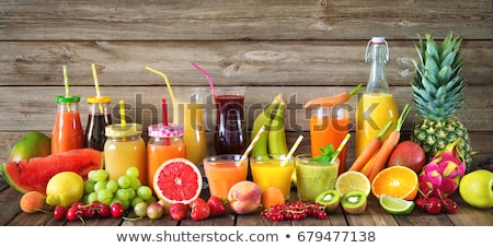 bottle with carrot juice, fruits and vegetables Stock photo © dolgachov