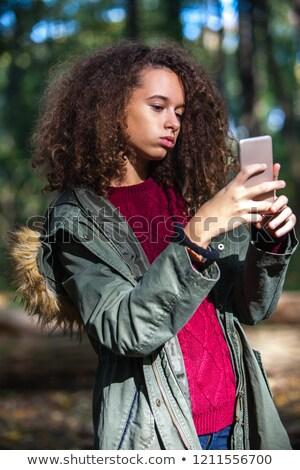 bonitinho · cabelos · cacheados · menina · adolescente · outono · floresta - foto stock © boggy