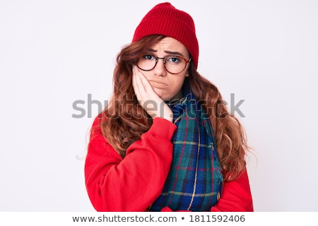 upset young woman wearing winter scarf standing stock photo © deandrobot