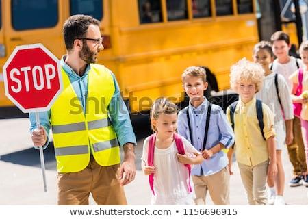 Children crossing the road in front of school Stock photo © colematt
