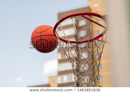Ball for playing basketball thrown by player close to basket Stock photo © pressmaster