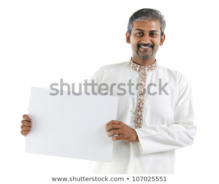 indian businessman with business card over grey stock photo © dolgachov