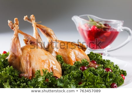 quail roasted with sweet and sour cranberry sauce Stock photo © olira