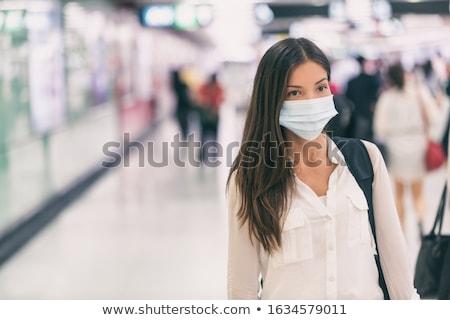 Kadın cerrahi maske tren otobüs istasyon Stok fotoğraf © Maridav