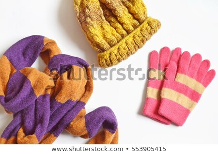 Knitted striped winter gloves in bright colors Stock photo © duoduo