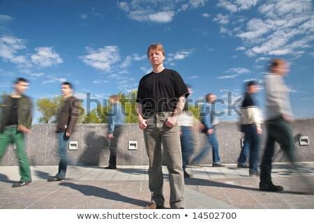 standing man among moving pedestrians Stock photo © Paha_L