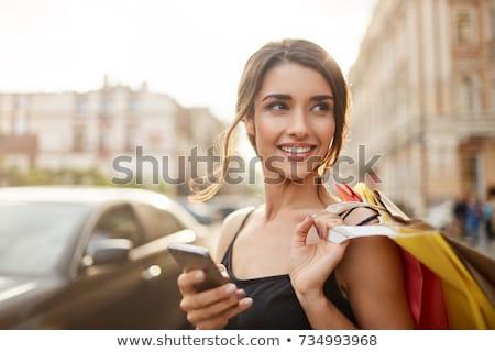 Vásárló nő vásárlás tart bevásárlótáskák piros Stock fotó © Ariwasabi