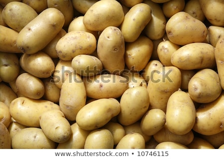 Close up of new potatoes outside a greengrocers. Stock photo © latent