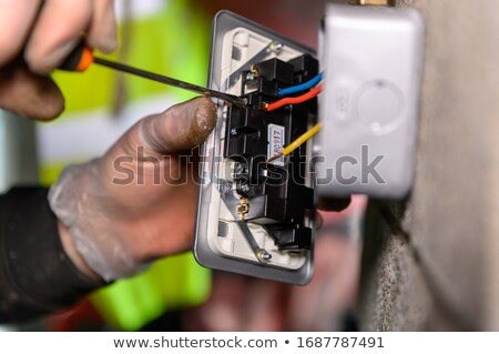 Electrician screwing plug stock photo © photography33