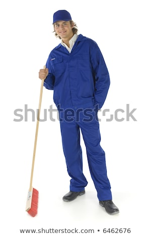 Young sweeping man workwear. Isolated Stock photo © shutswis