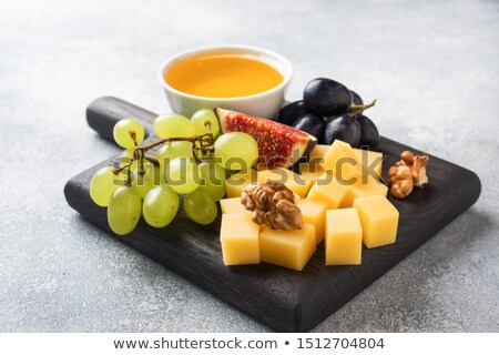 Stock photo: cheese on wooden background