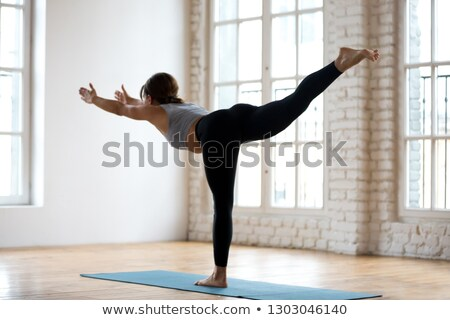 young woman doing fitness with a stick Stock photo © photography33