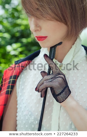 portrait of graceful blonde stroking her face Stock photo © photography33