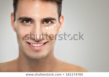 genç · krem · gülümseme · adam · portre · cilt - stok fotoğraf © ambro