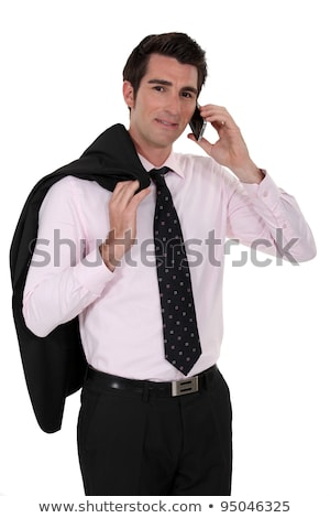 Arrogant businessman stood posing with jacket over shoulder Stock photo © photography33
