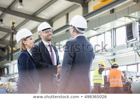 blue collar coworkers shaking hands Stock photo © photography33