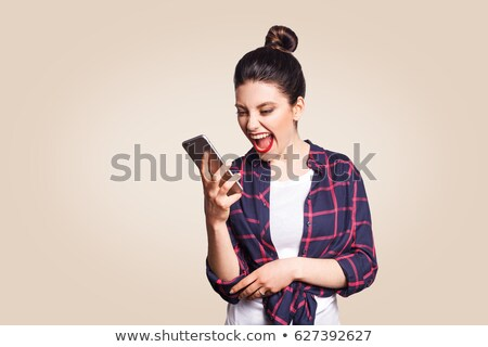 Shocked Young Woman Holding Smart Cell Phone on White Stock photo © feverpitch