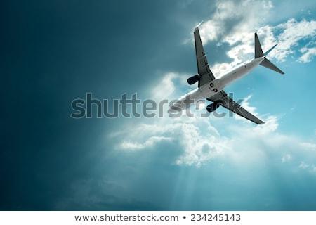 Repülőgép kilátás felhők férfi utazás repülőgép Stock fotó © lillo