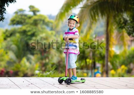 мало мальчика тротуаре только древесины Сток-фото © Talanis