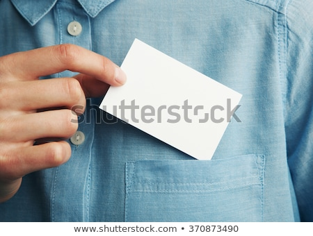 business man handing a blank business card at his office stock photo © hasloo