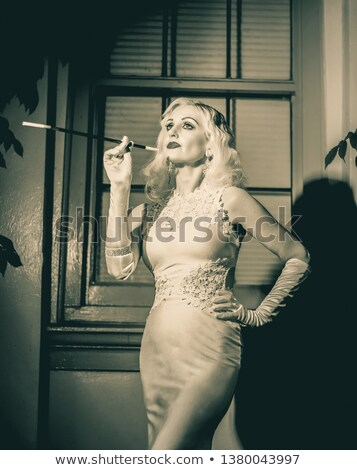 Portait of a curvaceous blonde Stock photo © stryjek