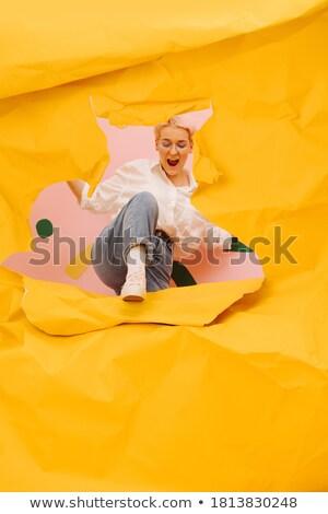 Jonge blonde vrouw voortvarend haren omhoog gelukkig Stockfoto © avdveen
