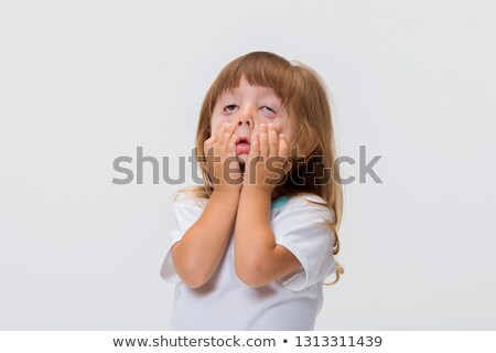 Little girl making a strange face on white background Stock photo © dacasdo