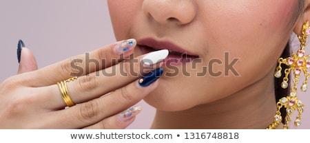 woman diamond pendant in mouth stock photo © dolgachov