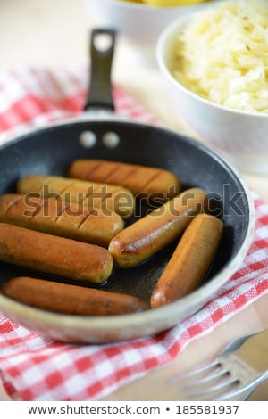 fried sausage with sourcrout stock photo © joker