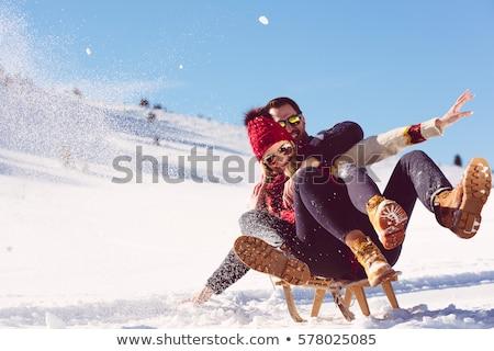 young couple sledding stock photo © monkey_business