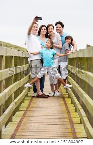 Multi Generation Family Walking On Bridge Taking Photo Stock photo © monkey_business