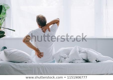 Neck and back pain Stock photo © dgilder