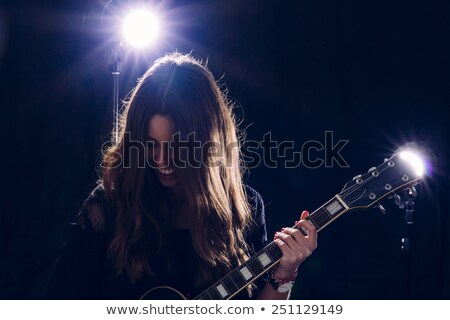 Lány tart gitár mikrofon sapka pulóver Stock fotó © feelphotoart