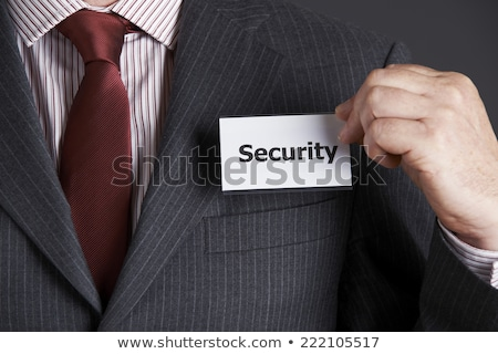 Businessman Attaching Security Badge To Jacket Stock photo © HighwayStarz