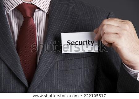 Businessman Attaching Security Badge To Jacket Stock photo © HighwayStarz