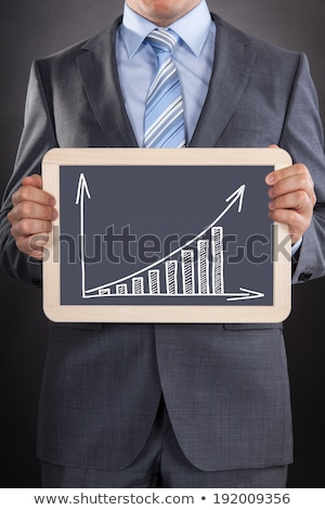Businessman Showing Bargraph Drawn On Slate Stock photo © AndreyPopov