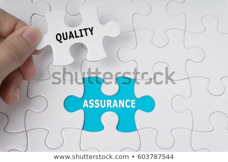 Businessman inspecting jigsaw puzzle Stock photo © AndreyPopov