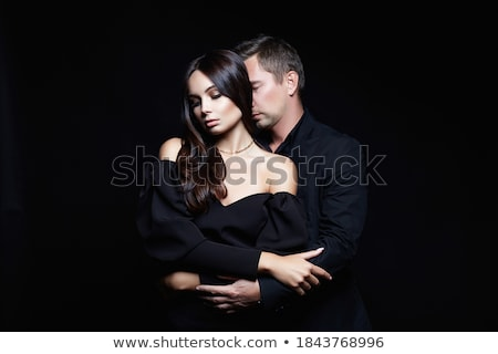 woman seducing man over black background stock photo © andreypopov