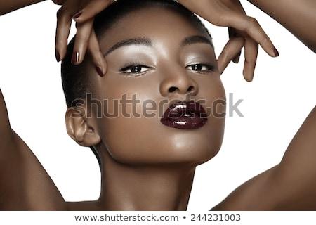 Elegant dark skinned woman posing Stock photo © NeonShot