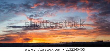 Bulutlu gün batımı yalnız tekne okyanus su Stok fotoğraf © ivz