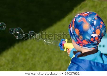 Azul brinquedo pistola plástico branco jogar Foto stock © dezign56