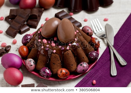 Easter cake and chocolate eggs Stock photo © laciatek