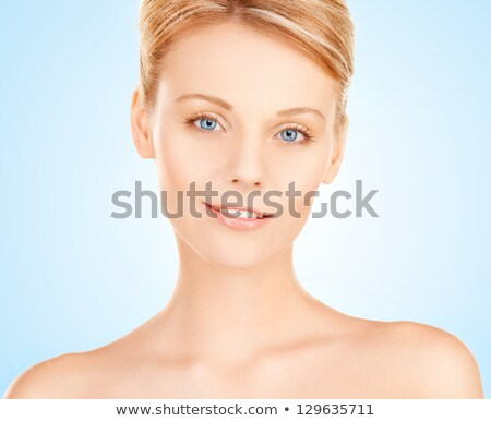 portrait of an alluring young blond woman stock photo © konradbak