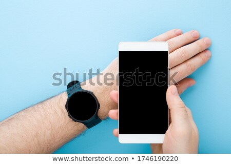 man walks with smartphone top view. Male and gadget phone Stock photo © popaukropa