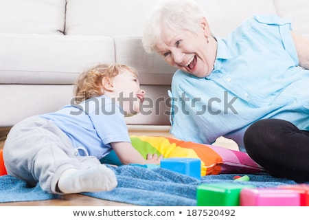 a grandmother playing with her grandson stock photo © is2