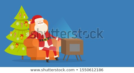 Sitting Santa Claus in Orange Armchair near TV Set Stock photo © robuart