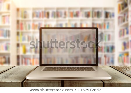 laptop with with screen against teacher reading books to her students stock photo © wavebreak_media