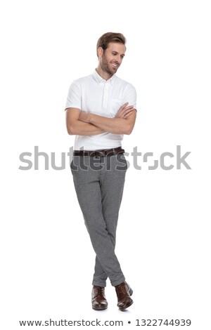 Nyugodt férfi áll lábak keresztbe lefelé néz fekete Stock fotó © feedough
